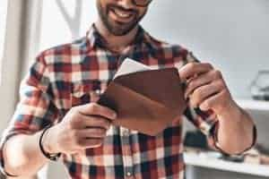 man opening gift card envelope