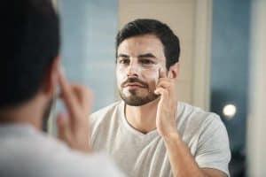 man washing his face; men skin care