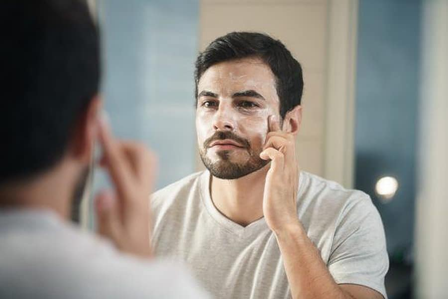 man washing his face; men skin care